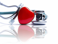 Heart next to a stethoscope.